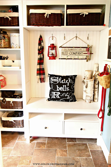 Christmas mudroom with red lantern and sled with diy chalkboard writing pillow.  www.goldenboysandme.com
