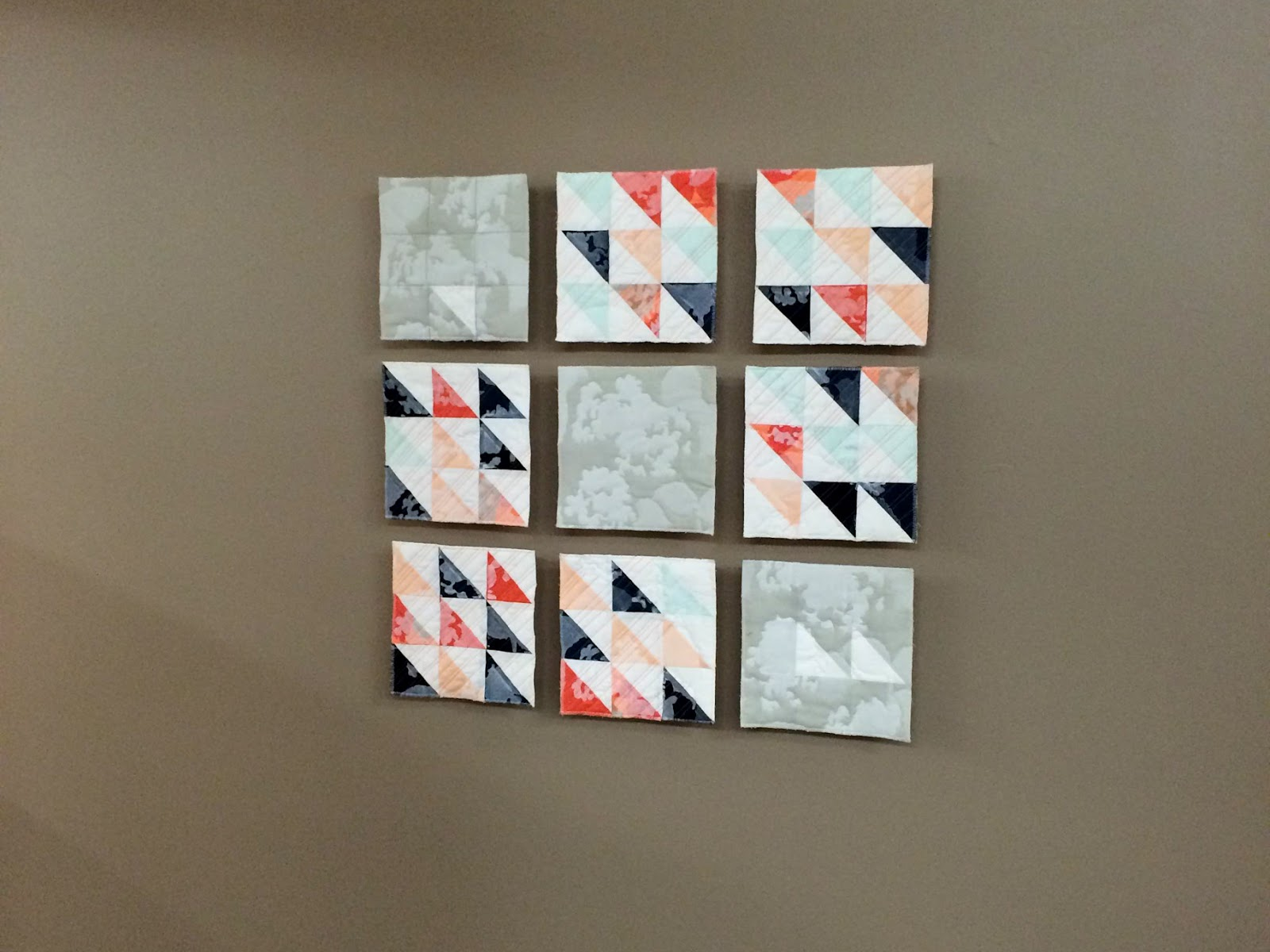 Remnants of Summer printed modern wall quilt living in its Wheaton College home   by Lovely and Enough