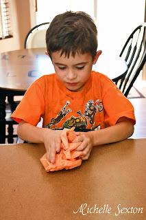 tissue paper crumpling by a preschooler