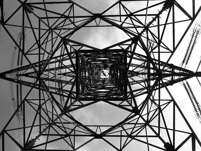 An electricity pylon from below, in black and white, on the Lion Rock trail, Hong Kong