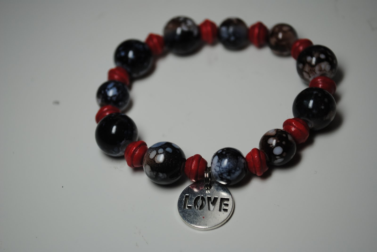 Around the World Bracelet with Love Charm - Black/Red $12