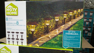 HGTV Home 8 Piece LED Solar Pathway Lights front of home