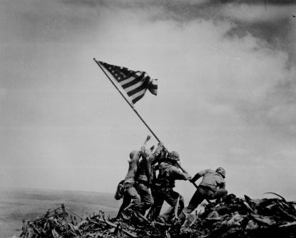 Placing the flag at Iwo Jima, 1945. Joe Rosenthal, AP