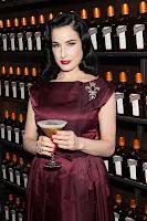 Dita Von Teese holding a drink