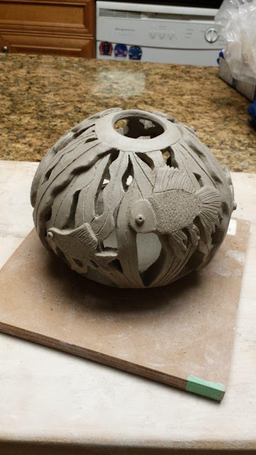 Ceramic handthrown carved pottery fish bowl sphere.