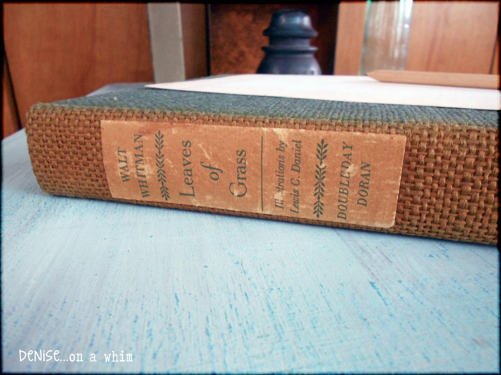 Vintage copy of Leaves of Grass with sun-faded binding via http://deniseonawhim.blogspot.com