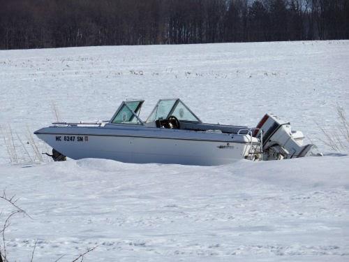 boat in snowy field