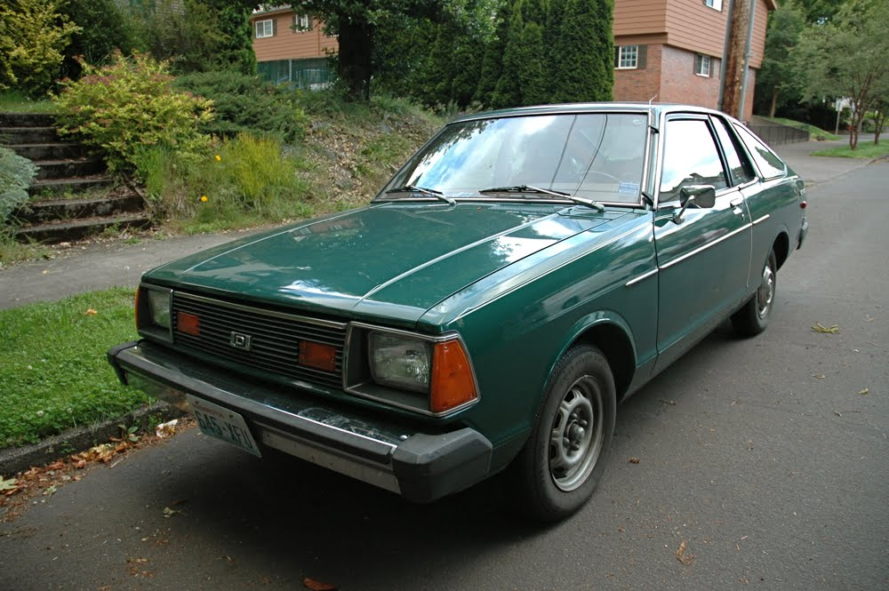 OLD PARKED CARS.: 1981 Datsun 210.