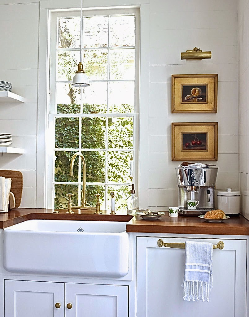 Kitchen with butcher block wood counters and farmhouse style sink