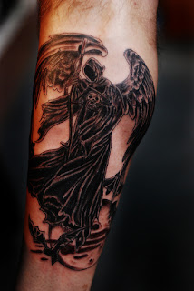 arm tattoo: Angel of Death / Grim Reaper