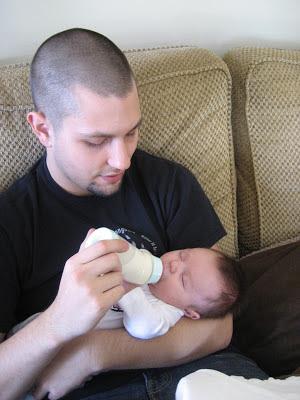 father feeding baby boy