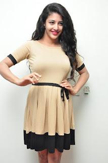 Daksha Nagar at Hora Hori Movie Interview ina Tight Beigh Colored Short Dress
