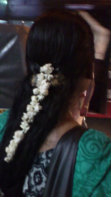 Semi loose long hair braid decorated with jasmine flowers