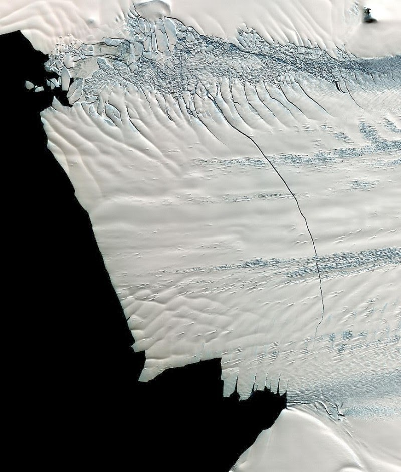 A satellite image of Pine Island Glacier shows an 18-mile-long crack across the glacier. Researchers used cracks and other physical features on the glaciers to calculate glacier acceleration by comparing image data from year to year to see how far the cracks traveled. (Credit: NASA) Click to enlarge.