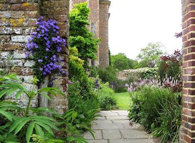 View of garden through brick gateway