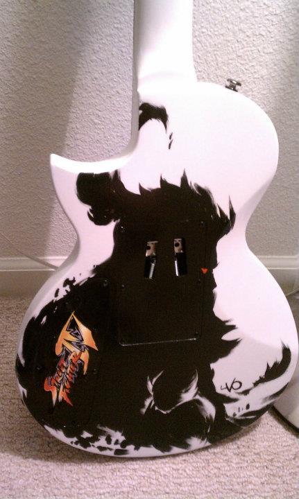 Guitarras pintadas con dibujos anime. 299382_10150314001589819_213182229818_7703732_1273098135_n