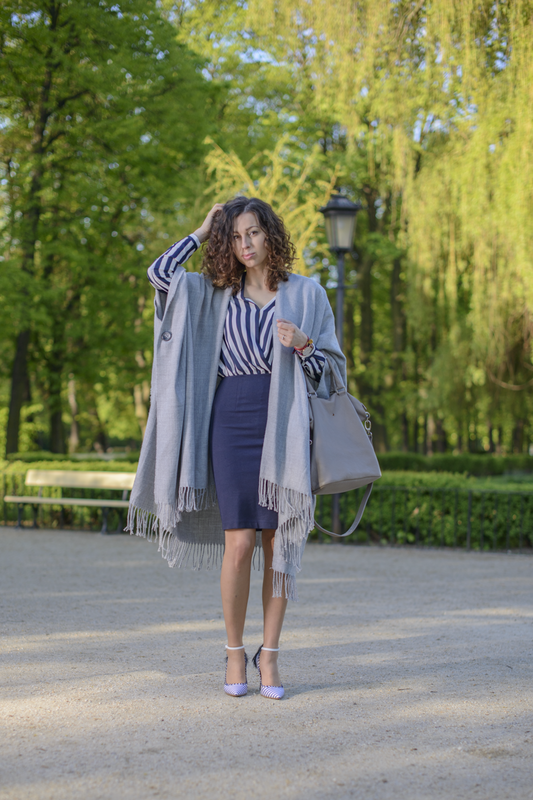 gray poncho with fringes street fashion