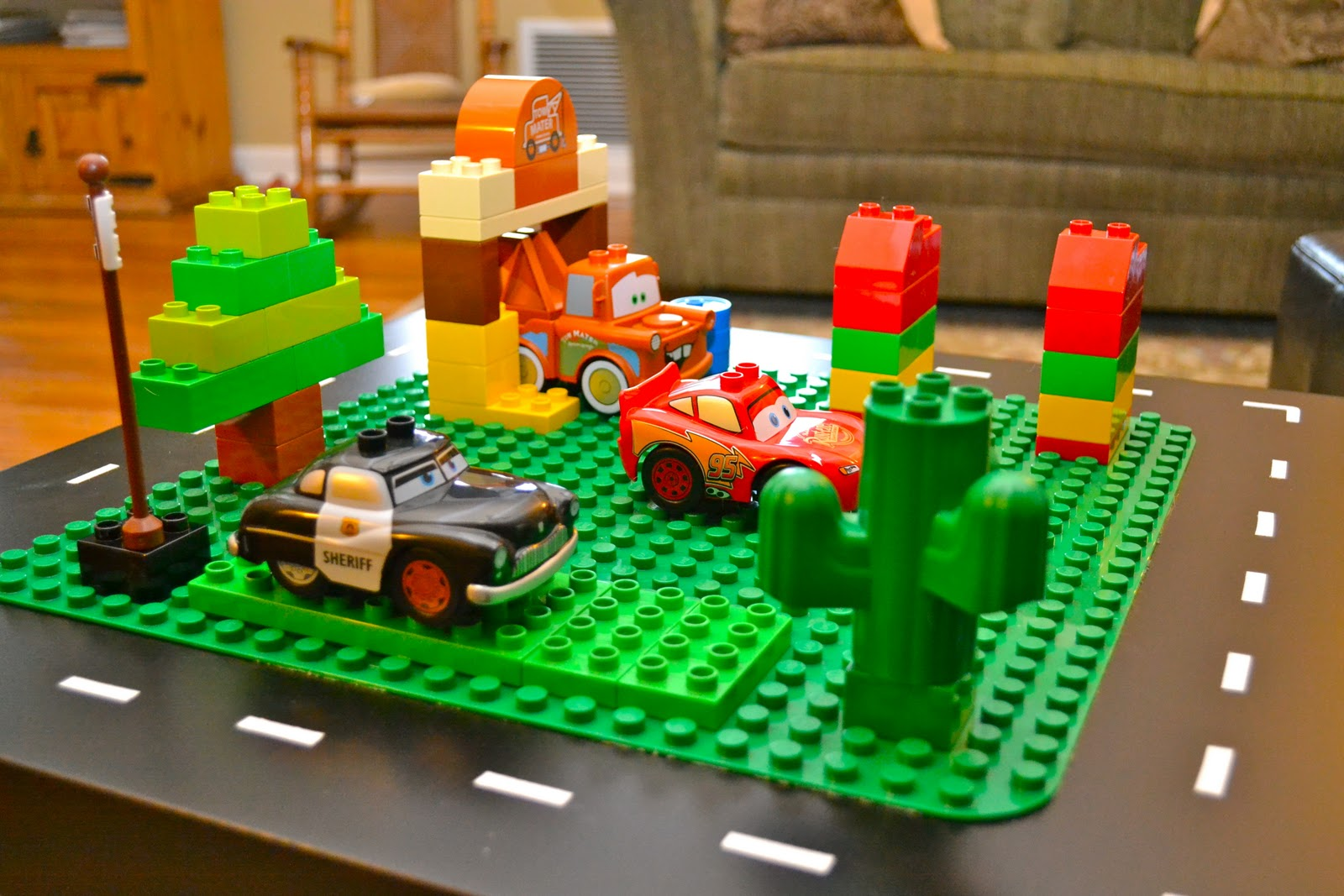 i ended up getting three sets of legos two with Cars characters and parts and one basic set plus a building board. i added the white stripes like a road ... & The Campbell Crew: lego table.