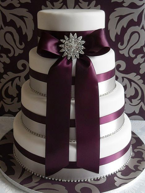 plum wedding cake with brooch