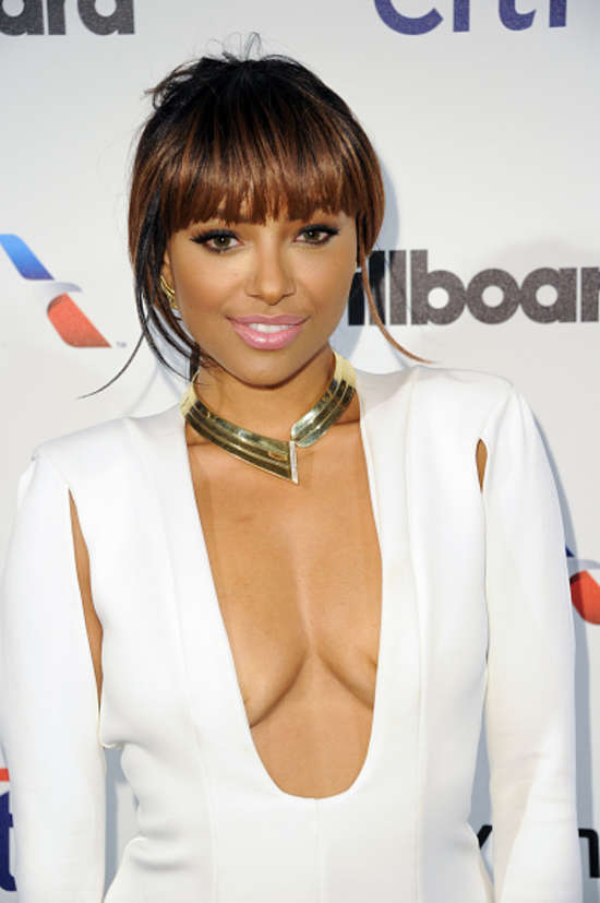 Kat Graham wears a plunging dress to the 2015 Billboard Power 100 Celebration in Beverly Hills