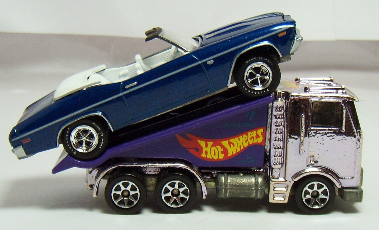 Finally maisto made one with the same exact ramp as the hot wheels version but the casting maisto used was a generic version of an isuzu coe truck