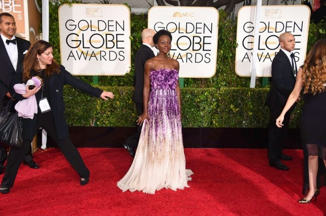 Lupita Nyong'o stuns in a purple Giambattista Valli dress at the 2015 Golden Globes