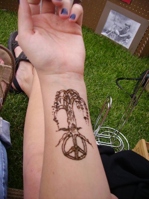 Hannikate peace sign tattoo designs for Peace tattoo designs