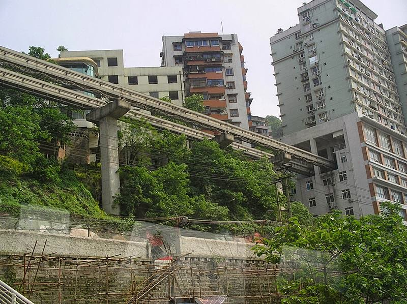 Monorail right through an apartment block  Part of Chongqing Rail Transit, the largest monorail system in the world.