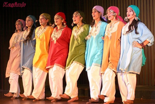 A wonderful group of Kashmiri girls in traditional Pheran performing the Kashmiri folk dance.