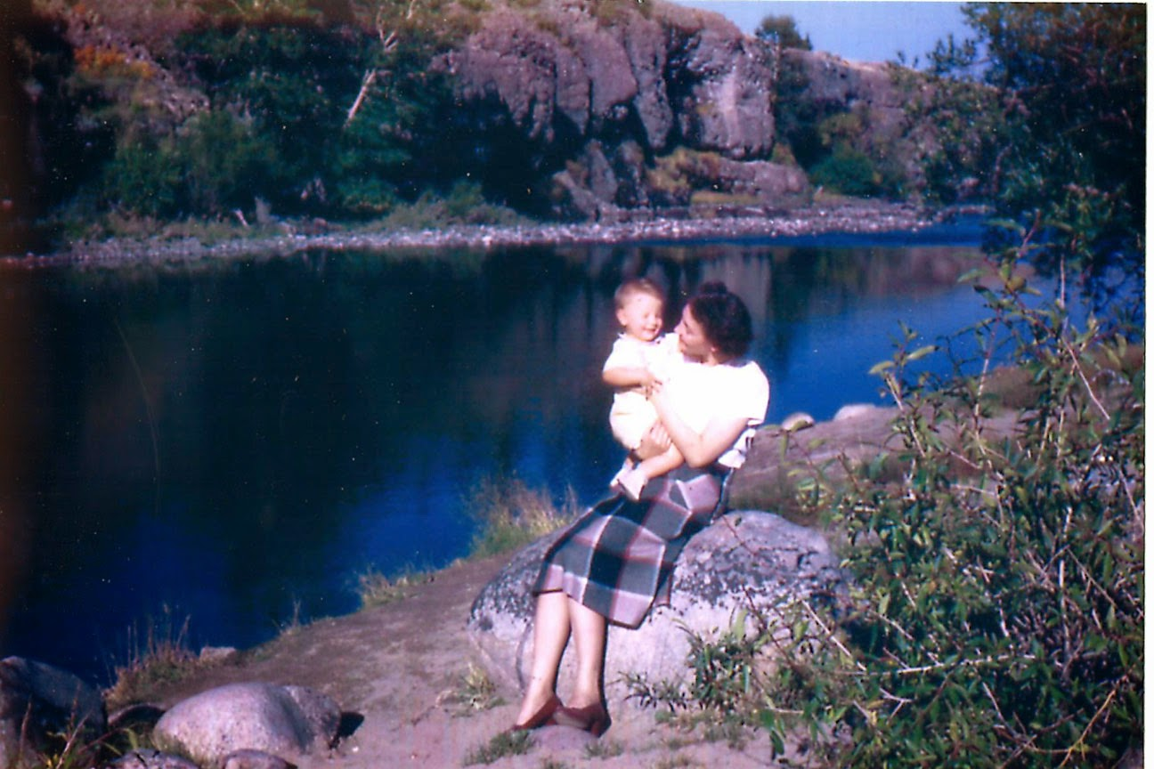 Momma and me as an infant on the banks of the Boulder River, Montana.