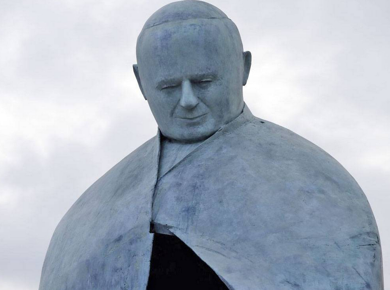 remodeled controversial statue of sitting Pope John Paul II is unveiled