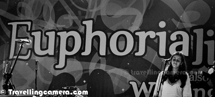 Most of the times when we talk about Euphoria, Palash Sen comes into our minds first while there are more folks in the crew who contribute a lot towards amazing performances of the band. This Photo Journey is dedicated to whole crew of Euphoria Band and their unmatchable energy..These are two main Guitarists of Euphoria Band and most of the times they were standing on both sides of Palash Sen who keeps moving on the stage. Debajyoti Bhaduri is on right and Amborish Saikia is in left of the photograph shown above. Palash Sen and Debajyoti Bhaduri were generous enough to move around for better utilization of stage made for this evening..Vinayak Gupta was playing keyboard and was standing just parallel to two Guitarists. He was towards the right side of the stage and he was mainly facing the public on one side. Since I was standing on right side of the stage, he blessed TravellingCamera with this pose during the performances at Steller Gymkhana, Greater Noida during Adobe carnival 2012 !!!Prashant Trivedi on Tabla and Ashwani Verma on Drums... They were positioned on left side of the stage and more towards the back sideHere are some top level details about the Euphoria Team -Dr. Palash Sen take care of Vocals and extreme stage performances :) ... Debajyoti Bhaduri takes care of Bass Guitar and handle it very well with some interesting expressions on his face :) ... Rakesh Bhardwaj plays one of the interesting instrument Dholak, which gives more pleasure than scrubbing fingers on guitar :) and he also takes care of Percussion ...Prashant Trivedi can be seen sitting with Tabla and Percussion on other side ... Ashwani Verma basically plays Drums, but has been instrumental in playing music with Drum-sticks and this particular music is used in one of the songs brilliantly... At the same time, the two girls create music through 'Chutkis' :) ...Vaishali Barua is one of the Back up vocals and Krutika Murlidharan is another Back up vocal... Vinayak Gupta on Keyboards with alway