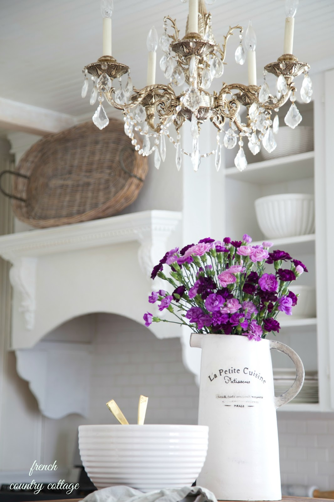 Courtney at french country cottage decorated the kitchen - Fresh Purple Flowers In A Vintage French Inspired Pitcher