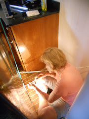Replacing the back panel of the refrigerator.
