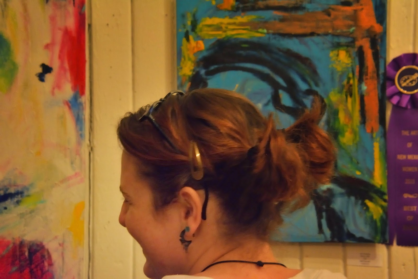 Image of young woman appreciating art March 7, 2015 in Raton, New Mexico.