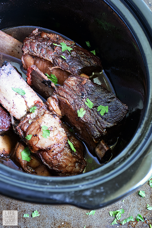 Slow Cooker Red Wine Short Ribs   by Life Tastes Good are fall off the bone tender and melt in your mouth with a rich, succulent flavor that can only be described as luxurious. #LTGrecipes