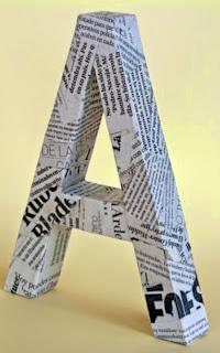 http://manualidadesreciclables.com/14869/hacer-letras-3d-con-carton