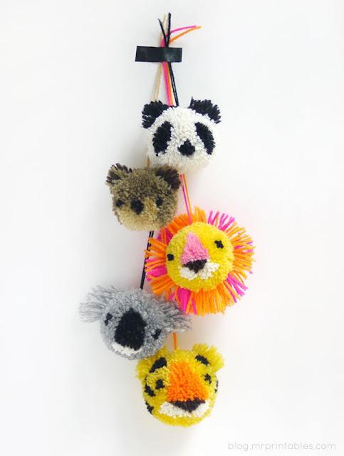 http://bearandlionmama.com/2014/01/cute-pom-pom-crafts.html
