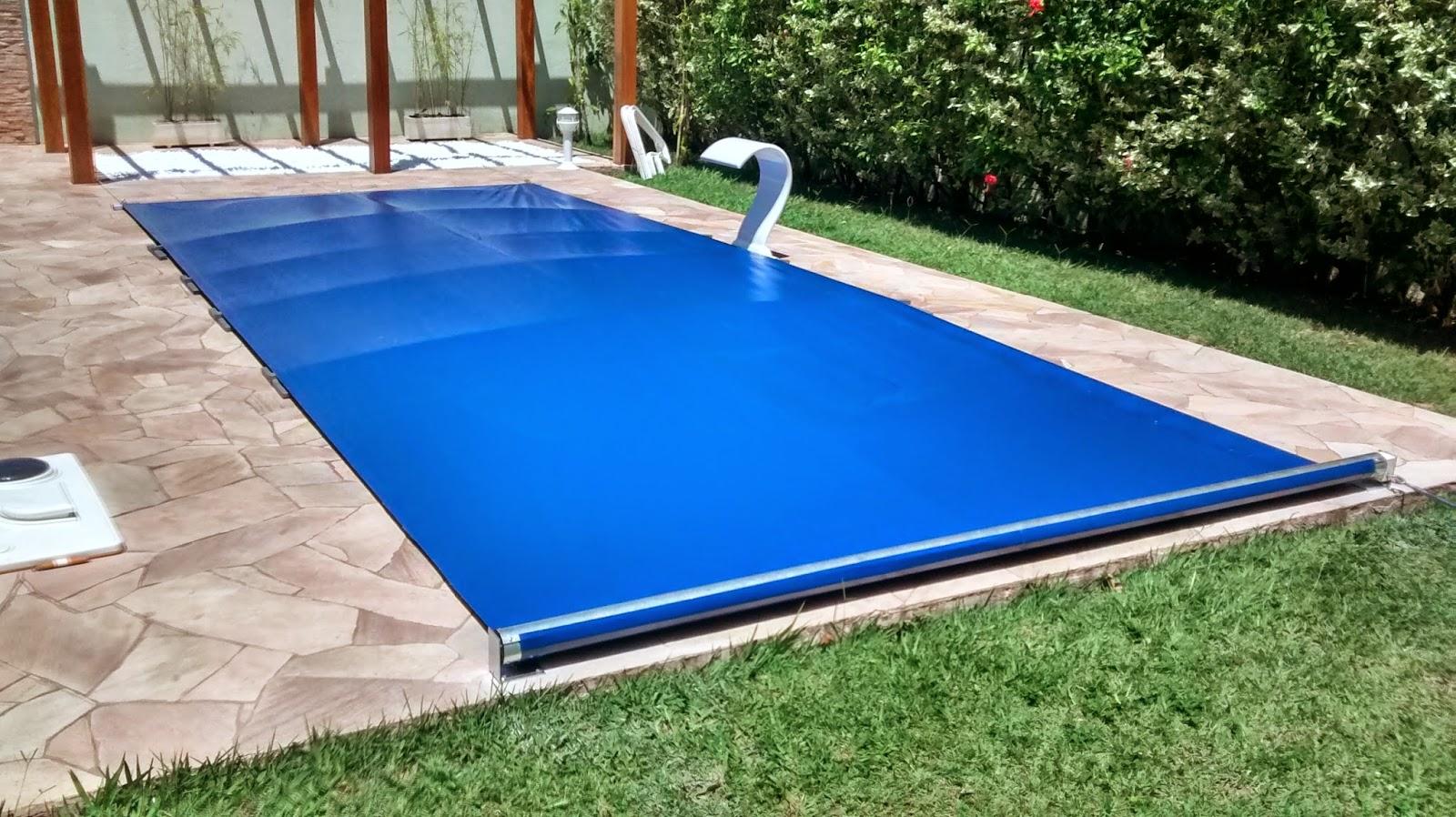 Capa de piscina de enrolar toldos garcia for Toldos para piscinas