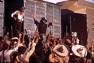 Rod Steiger as the Mexican bandit Juan Miranda, hailed as the hero Juan of Revolution, James Coburn as IRA (Irish) dynamite expert John H. Mallory in Duck, You Sucker, Directed by Sergio Leone