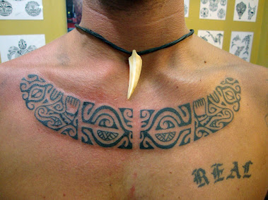 french polynesian style chest tattoo