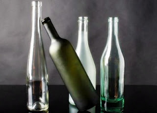 How to Decorate Glass Bottles With Napkins