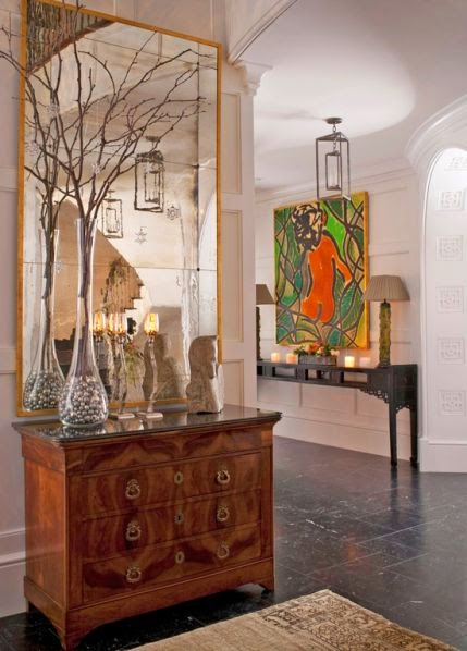 beautiful foyer room with gold and modern art vignette