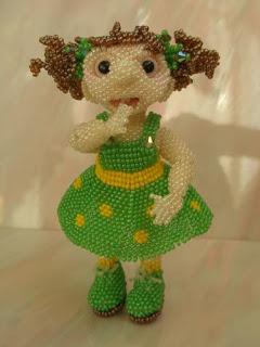 Куколка из бисера объемная