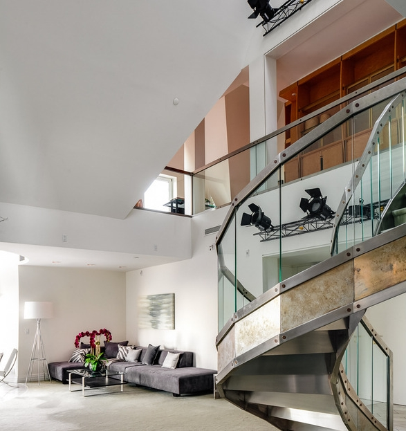 Modern living room with iron and glass staircase