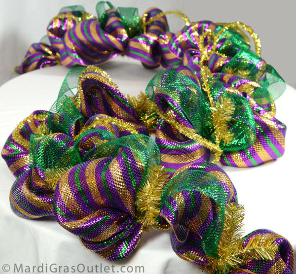 The finished Mardi Gras garland made with a work garland form, deco mesh and tinsel roping.