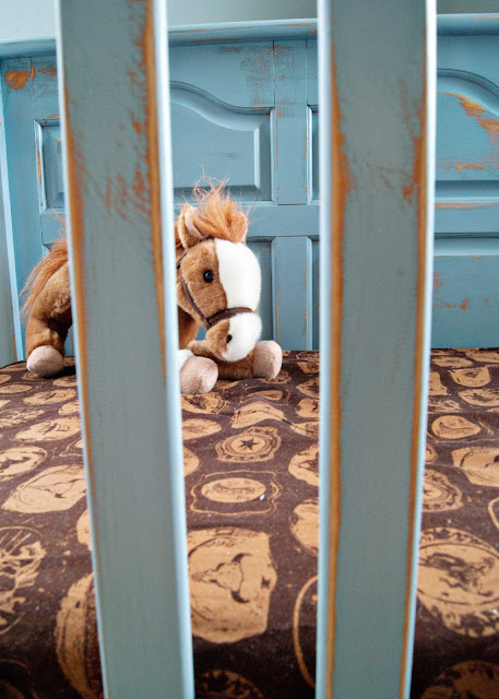 Distressed blue crib makeover
