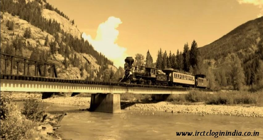 steam engine train running over bridge