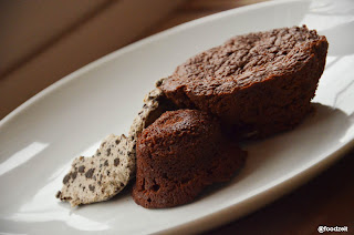 Brownies on a plate with a scoop of straciatella ice cream