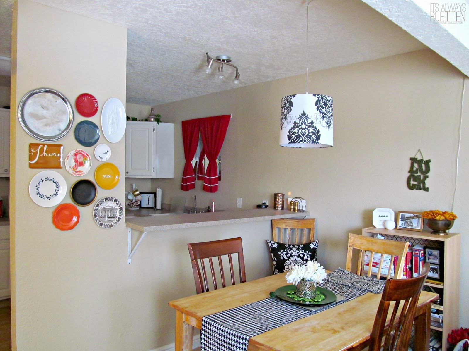 Plate wall in a rental dining room